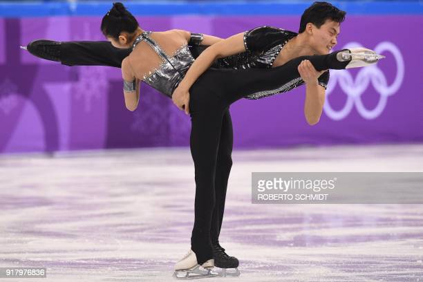 North Korea's Kim Ju Sik and North Korea's Ryom Tae Ok compete in the pair skating short program of the figure skating event during the Pyeongchang...