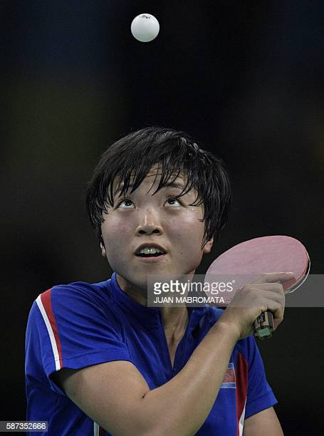 North Korea's Kim Song I eyes the ball as she plays against Taiwan's Chen SzuYu during their women's singles qualification round table tennis match...