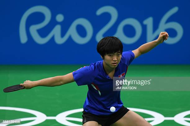 North Korea's Kim Song I hits a shot against China's Ding Ning in their women's singles semifinal table tennis match at the Riocentro venue during...