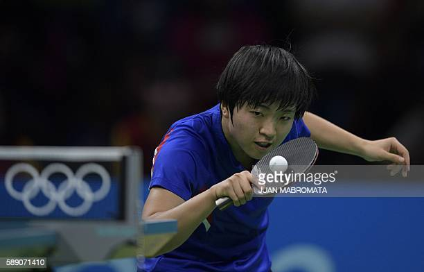 North Korea's Kim Song I hits a shot in a women's team quarterfinal table tennis match against China at the Riocentro venue during the Rio 2016...