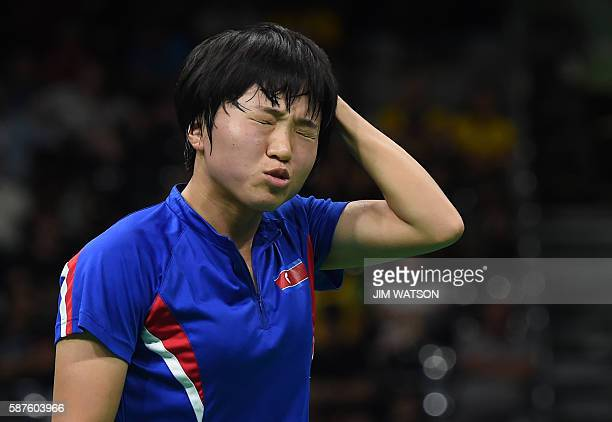 TOPSHOT North Korea's Kim Song I reacts between points against Singapore's Yu Mengyu in their women's singles quarterfinal table tennis match at the...