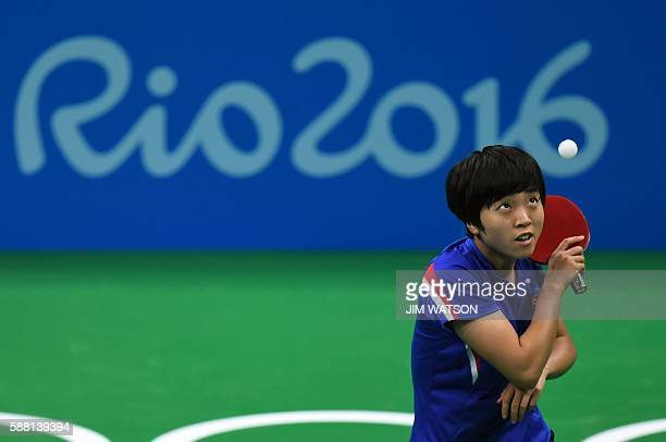 North Korea's Kim Song I serves against China's Ding Ning in their women's singles semifinal table tennis match at the Riocentro venue during the Rio...