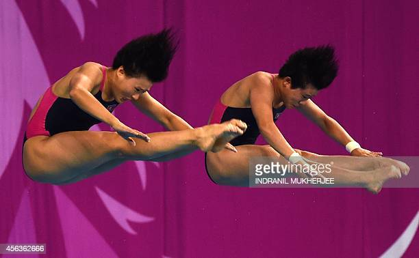 North Korea's Kim Ungyong and Song Namhyang compete during the women's synchronised 10m platform diving final of the 2014 Asian Games at the Munhak...