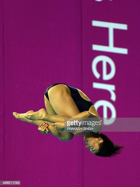 North Korea's Kim Unhyang performs during the women's 10m platform diving final of the 2014 Asian Games at the Munhak Park Taehwan Aquatics Center in...