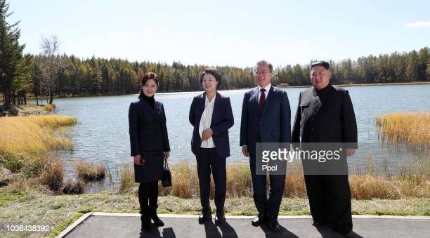 North Korea's leader Kim Jong Un and his wife Ri Sol Ju pose with South Korean President Moon Jaein and his wife Kim Jungsook during a visit to...