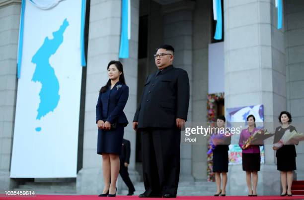 North Korea's leader Kim Jong Un and his wife Ri Sol Ju wait for South Korean President Moon Jaein at Pyongyang Grand Theater on September 18 2018 in...