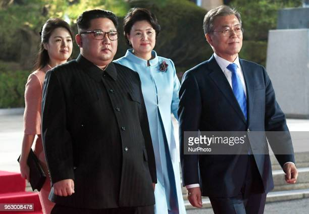 North Korea's leader Kim Jong Un and his wife Ri Sol Ju walk with South Korea's President Moon Jaein and his wife Kim Jungsook during a farewell...
