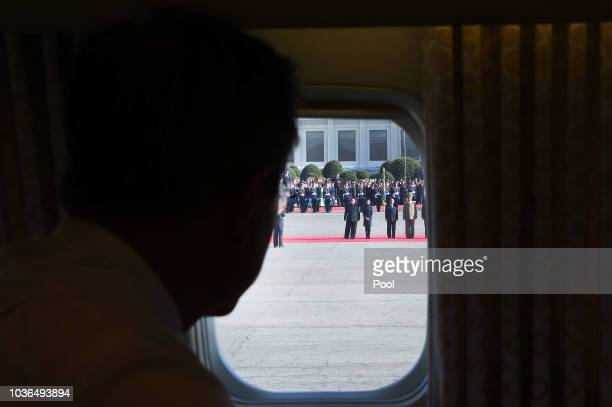 North Korea's leader Kim Jong Un and his wife Ri Sol Ju wave farewell to South Korean President Moon Jaein at Moon's departure from North Korea at...