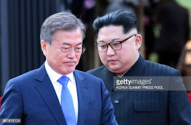 North Korea's leader Kim Jong Un and South Korea's President Moon Jaein walk to announce a joint statement after a signing ceremony near the end of...