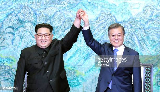 North Korea's leader Kim Jong Un and South Korea's President Moon Jaein pose during a signing ceremony near the end of their historic summit at the...