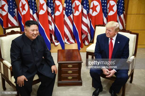 North Korea's leader Kim Jong Un and US President Donald Trump attend a meeting on the south side of the Military Demarcation Line that divides North...