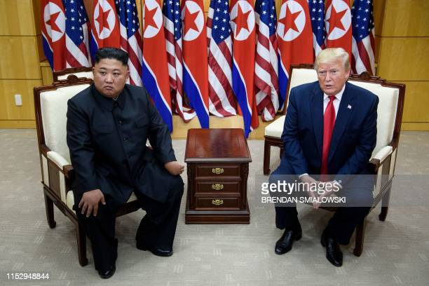 North Korea's leader Kim Jong Un and US President Donald Trump meet on the south side of the Military Demarcation Line that divides North and South...