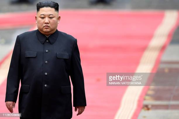 TOPSHOT North Korea's leader Kim Jong Un attends a welcoming ceremony and review an honour guard at the Presidential Palace in Hanoi on March 1 2019