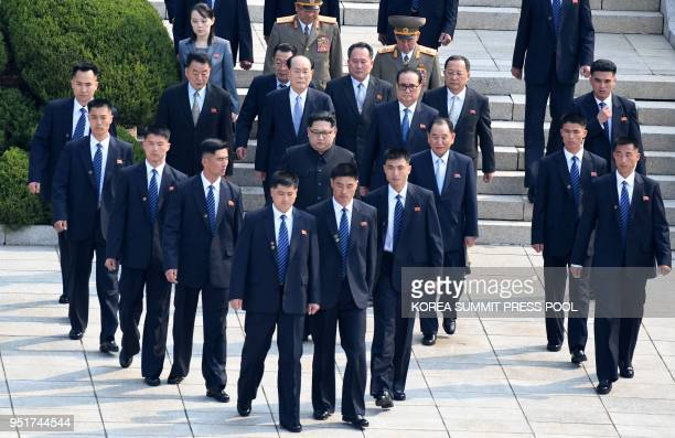 North Korea's leader Kim Jong Un is escorted by North Korean bodyguards as he walks from the North to the Military Demarcation Line that divides the...