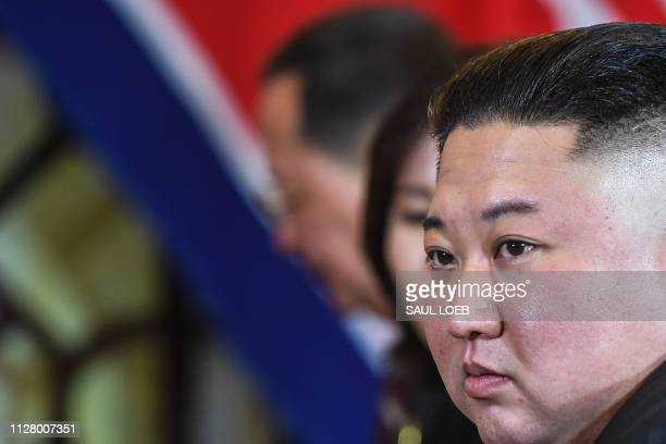 North Korea's leader Kim Jong Un listens during a bilateral meeting with US President Donald Trump at the second US-North Korea summit at the Sofitel...