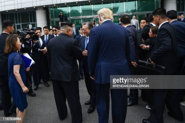 North Korea's leader Kim Jong Un meets with South Korea's President Moon Jae-in as US President Donald Trump look on south of the Military...