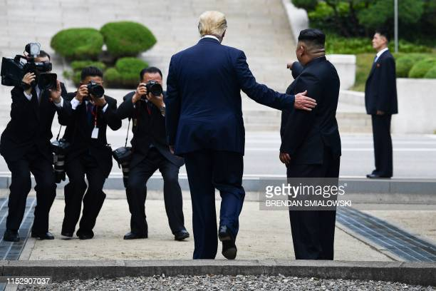 North Korea's leader Kim Jong Un poses with US President Donald Trump north of the Military Demarcation Line that divides North and South Korea in...