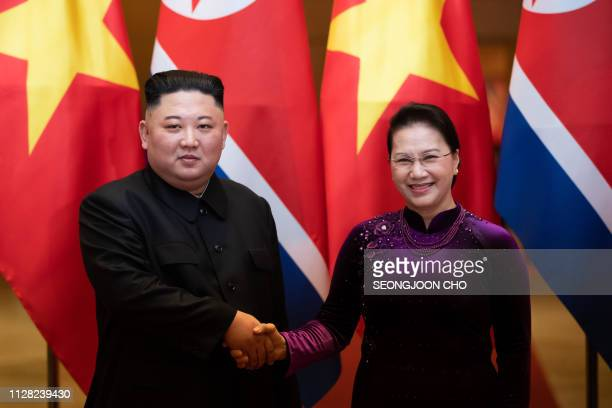 North Korea's leader Kim Jong Un shakes hands with Vietnam's National Assembly chairwoman Nguyen Thi Kim Ngan during a bilateral meeting in Hanoi on...