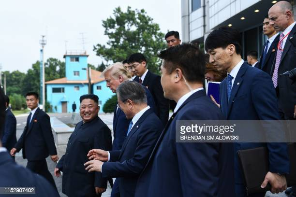 North Korea's leader Kim Jong Un South Korea's President Moon Jaein and US President Donald Trump walk following a meeting on the south side of the...