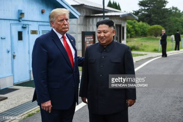 North Korea's leader Kim Jong Un stands with US President Donald Trump south of the Military Demarcation Line that divides North and South Korea in...