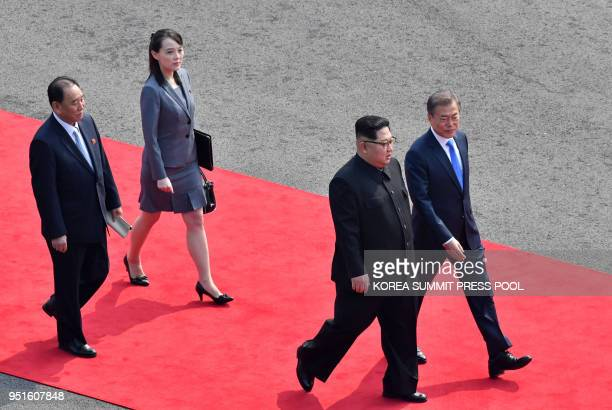 North Korea's leader Kim Jong Un walks with South Korea's President Moon Jaein followed by Kim's sister and close adviser Kim Yo Jong down a red...