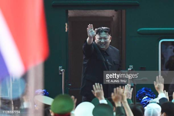 North Korea's leader Kim Jong Un waves before boarding his train at the Dong Dang railway station in Lang Son on March 2 2019