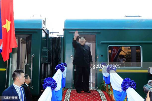 TOPSHOT North Korea's leader Kim Jong Un waves before boarding his train at the Dong Dang railway station in Lang Son on March 2 2019 / The erroneous...