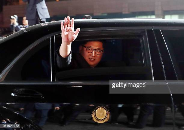 North Korea's leader Kim Jong Un waves in a car as he leaves for the North after a closing ceremony at the end of the historic summit with South...