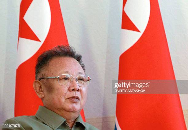 North Korea's leader Kim Jong-Il speaks with Russian President Dmitry Medvedev during their meeting at Sosnovy Bor Military Garrison, Zaigrayevsky...