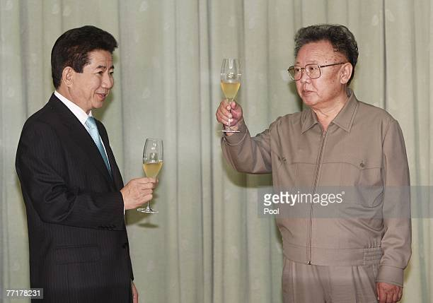 North Korea's leader Kim JongIl toasts with South Korea's President Roh MooHyun after they exchanged their joint statement on October 4 2007 in...