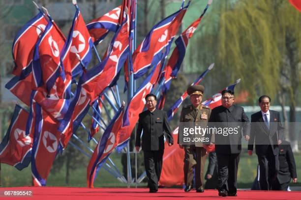 North Korea's leader Kim JongUn attends a ceremony for the opening of a housing project in Pyongyang on April 13 2017 With thousands of adoring North...