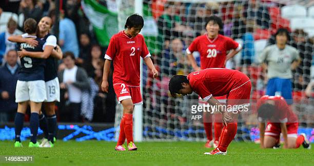 North Korea's midfielder Choe Un Ju reacts at the final whistle after losing 10 during the London 2012 Olympic Games women's football match between...