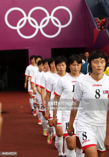 North Korea's Myong Hwa Jon walks out with her team before the Colombia v North Korea WomenOtildes Football First Round Group G match at Hampden Park...