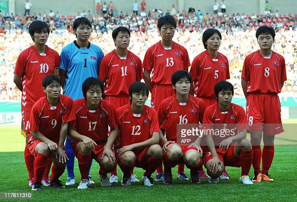 North Korea's national woman's soccer team poses for a group picture Yun Mi Jo goalkeeper Myong Hui Hong Ye Gyong Ri Un Ju Kim Jong Sun Song and Su...