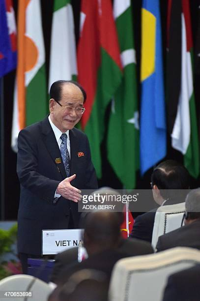 North Korea's nominal head of state, Kim Yong-Nam , shakes hands with Vietnam's President, Truong Tan Sang , after delivering a speech at a plenary...