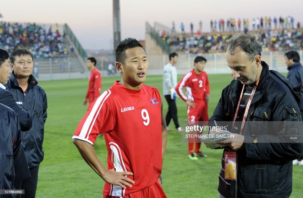 North Korea's player Jong Tae-Se (C) is interviewed by a journalist during an international friendly football match against Nigeria at Makhulong stadium on June 6, 2010 in Tembisa . The 2010 FIFA World Cup football championship is due to take place in South Africa from June 11 to July 11 of 2010.