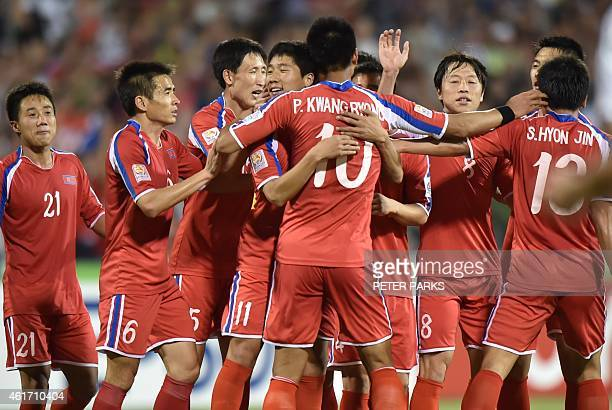 North Korea's players celebrate after scoring a goal against China during their Group B football match at the AFC Asian Cup in Canberra on January 18...