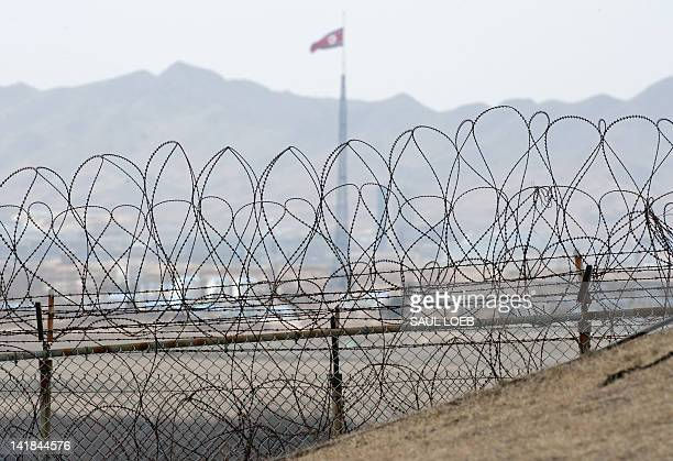 North Korea's propaganda showcase village of Gijeongdong is pictured from the Observation Post Ouellette in the Joint Security Area of the...