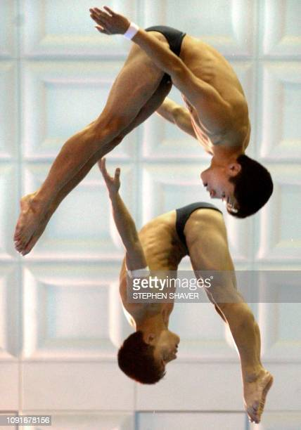 North Korea's Ri JongNam and Jo ChoRyong perform in the men's 10m Synchronized Diving event 08 October 2002 at the 14th Asian Games in Busan China...