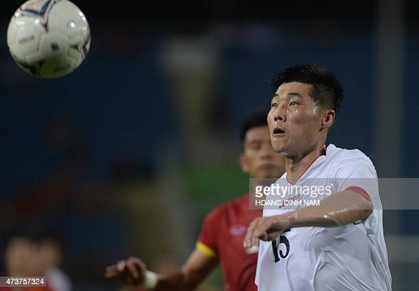 North Korea's Ri Yong Chol fights for the ball with Vietnam's Nguyen Quang Hai during a friendly match at Hanoi's My Dinh stadium in Hanoi on May 17...