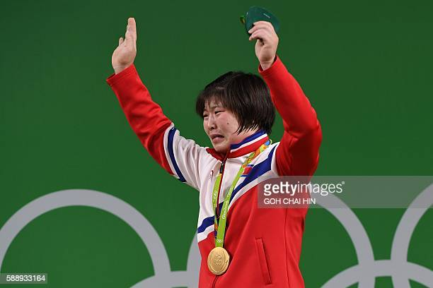 TOPSHOT North Korea's Rim Jong Sim cries on the podium after winning the gold medal during the women's weightlifting 75kg event during the Rio 2016...