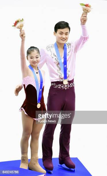 North Korea's Ryom Tae Ok and Kim Ju Suk acknowledge the crowd on the podium after winning bronze in the Asian Winter Games pairs figure skating in...