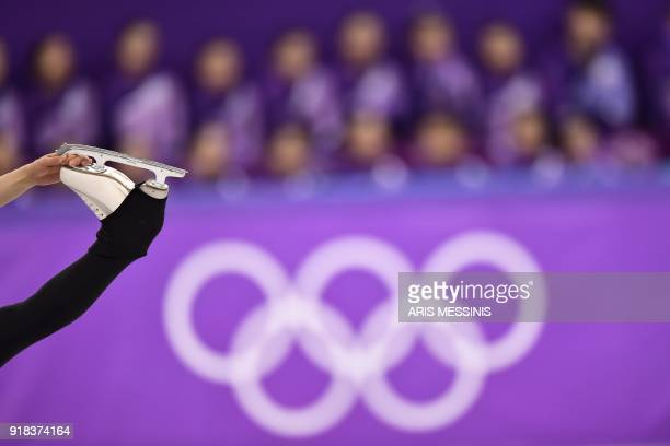 TOPSHOT North Korea's Ryom Tae Ok and North Korea's Kim Ju Sik compete in the pair skating free skating of the figure skating event during the...
