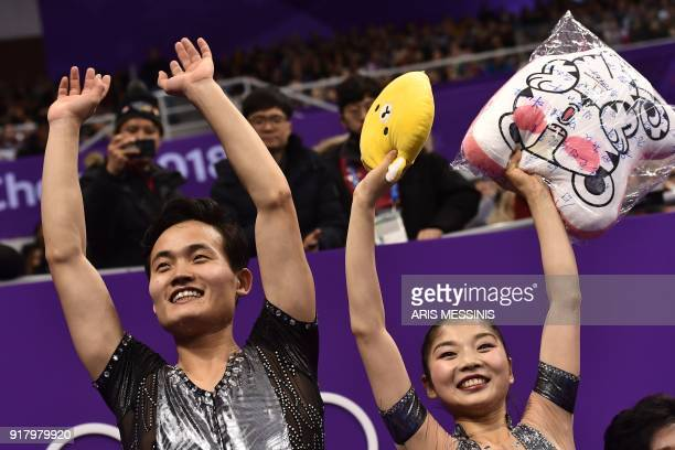 TOPSHOT North Korea's Ryom Tae Ok and North Korea's Kim Ju Sik react after competing in the pair skating short program of the figure skating event...