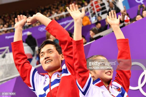 TOPSHOT North Korea's Ryom Tae Ok and North Korea's Kim Ju Sik react after the pair skating free skating of the figure skating event during the...