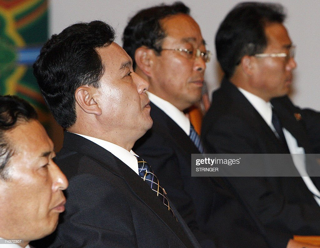 North Korea's Senior Cabinet Councillor Kwon Ho-ung (2nd L) and other North Korean delegation members participate in a meeting with South Korean delegation (not pictured) during their final meeting of the inter-Korean ministers' talks in Seoul, 01 June 2007. North and South Korea issued a brief statement after four days of high-level talks ended without any agreement. The South's Unification Ministry had said earlier in the day that no joint statement would be issued amid disagreements over delays in rice aid.