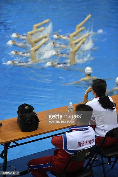 North Korea's synchronised swimming team practices at the Munhak Park Taehwan Aquatics Center in Incheon on September 17 2014 The 17th Asian Games...