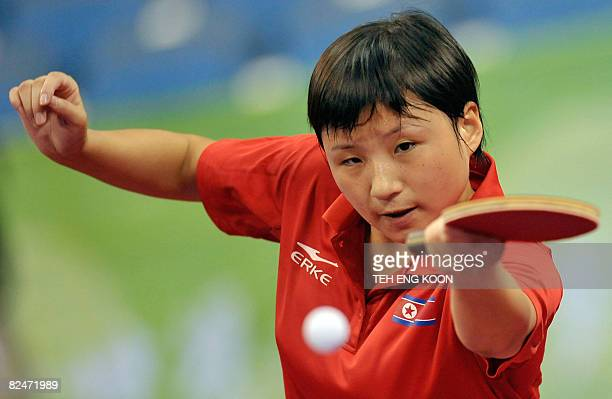 North Korea's table tennis player Kim Jong plays against Romania's Daniela Dodean in their women's singles table tennis preliminary round match at...