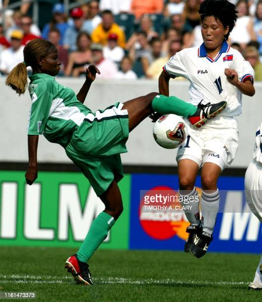 North Korea's Yun Yong Hui tries to block a shot from Nigeria's Florence Omagbemi during their match in the FIFA Women's World Cup USA 2003 at...