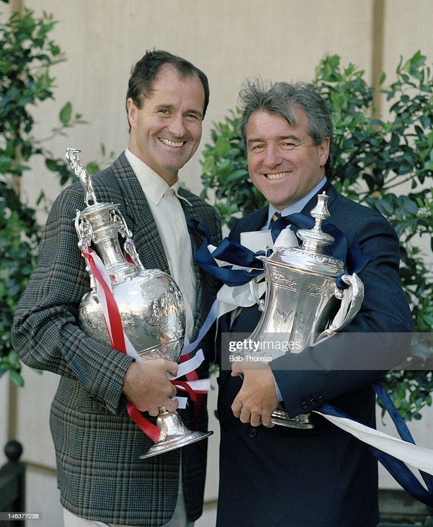 A North London 'Double' with Arsenal manager George Graham (left) holding the First Division League Championship trophy and Tottenham Hotspur manager Terry Venables holding the FA Cup during an exclusive photo session in London, 13th June 1991.